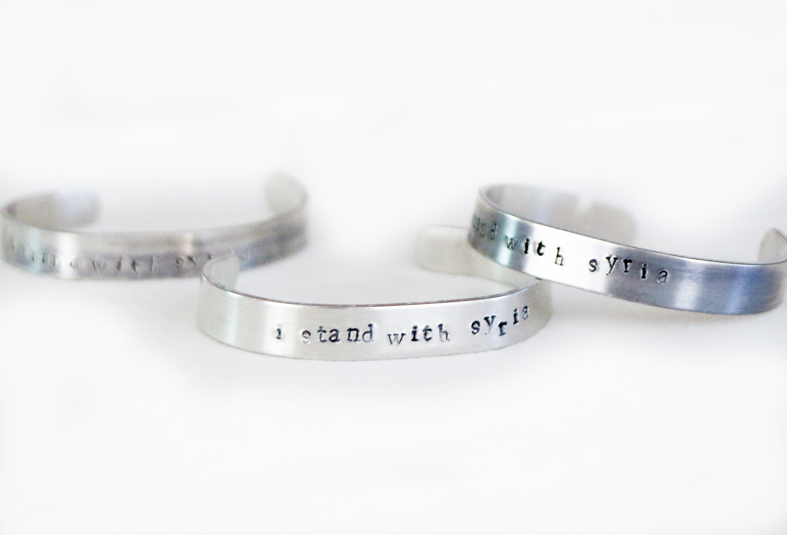 "These ""I Stand with Syria"" metal bracelets were made for the Wisdom House and make the perfect gift."
