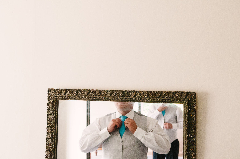 Trent's Estate Vineyard Wedding, Chris adjusting his tie.