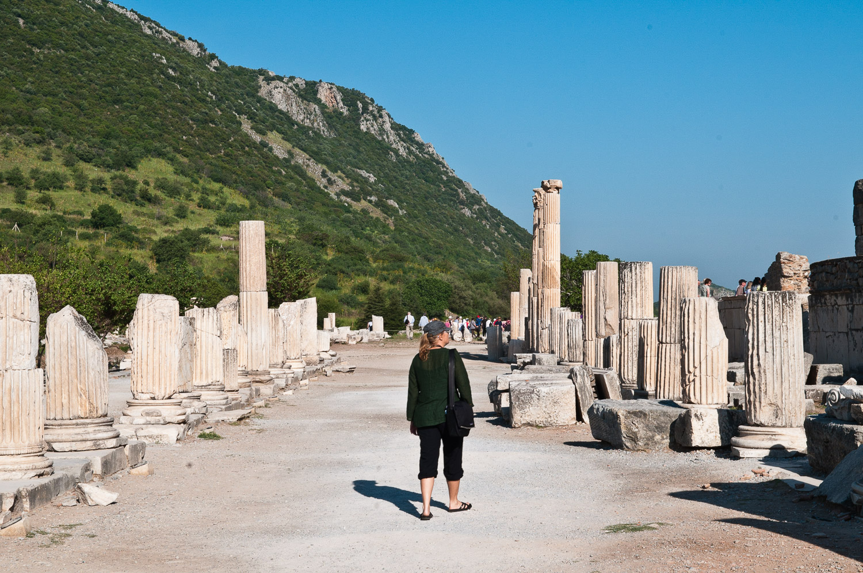 Woman walking amongst ruins, Ephesus, Turkey.