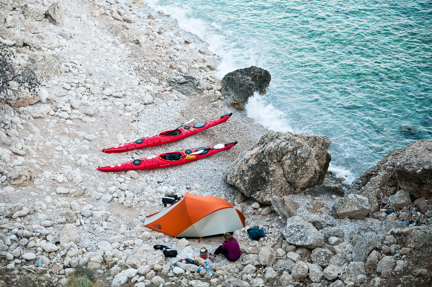 Woman sea kayaker camping, while paddling the Turquoise Coast, Turkey.