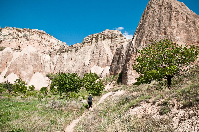 Woman walking amongst stone formations near Cappadocia, Turkey.