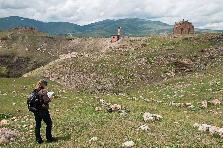 Woman exploring the old Silk Road fort near Kars, Turkey.