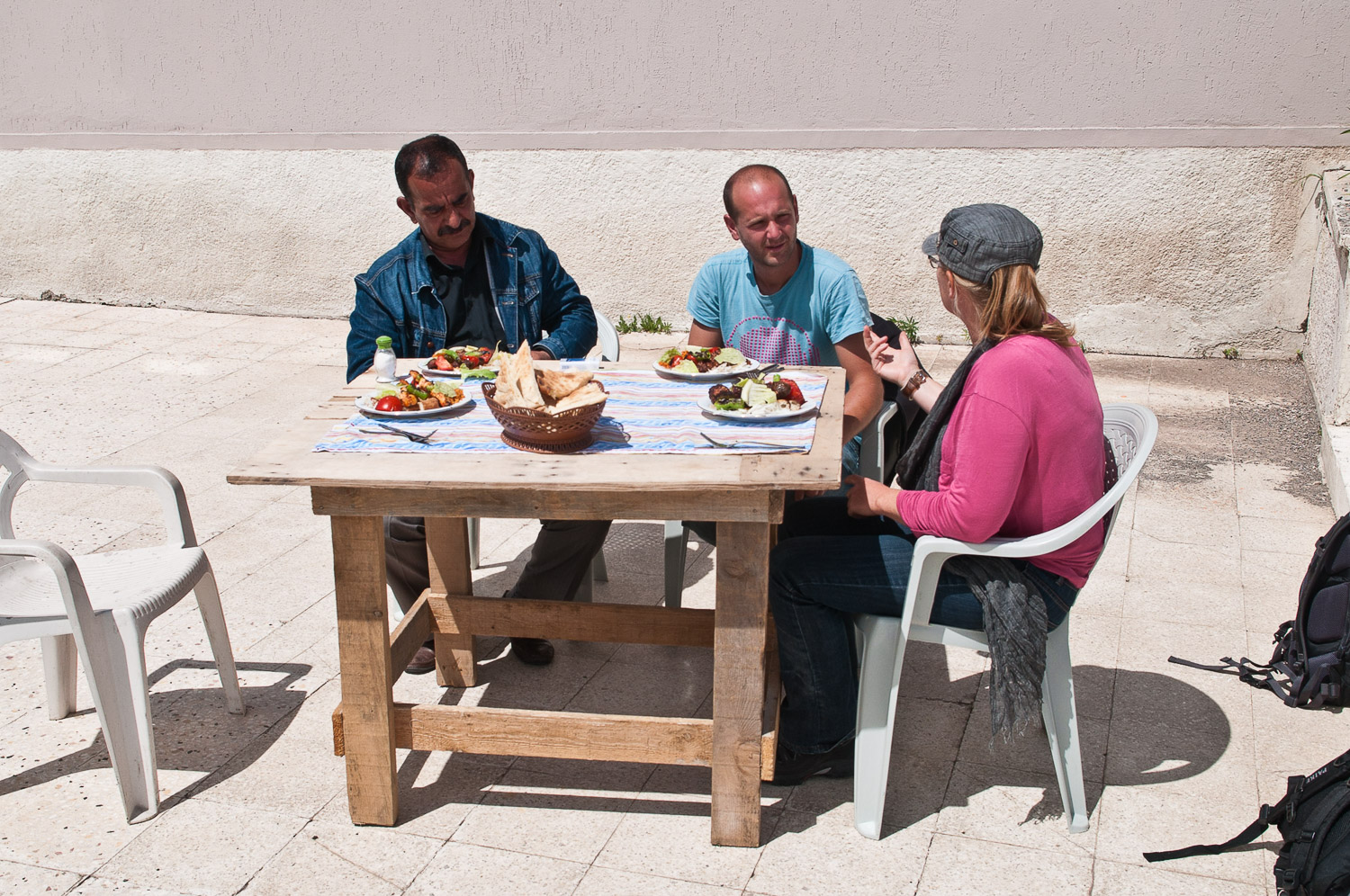 Tourists and guide eating lunch, near Kars Turkey.