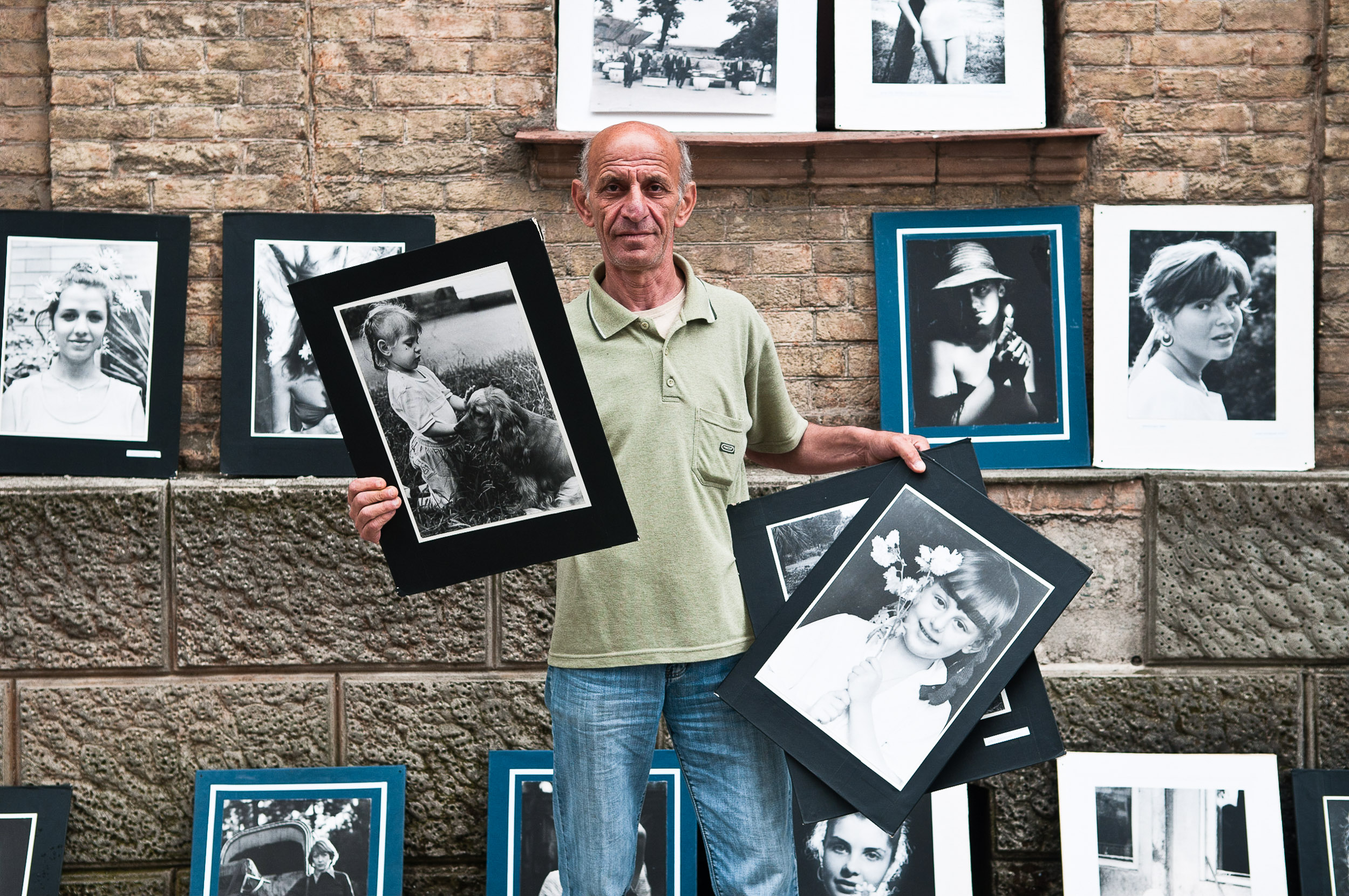 Photographer holding samples of his work, on the streets of Batumi, Georgia, on the 31 May 2012. The photographer set up a display of his photographs on the side walk of the streets of Batumi and was selling prints for $5 USD a piece.