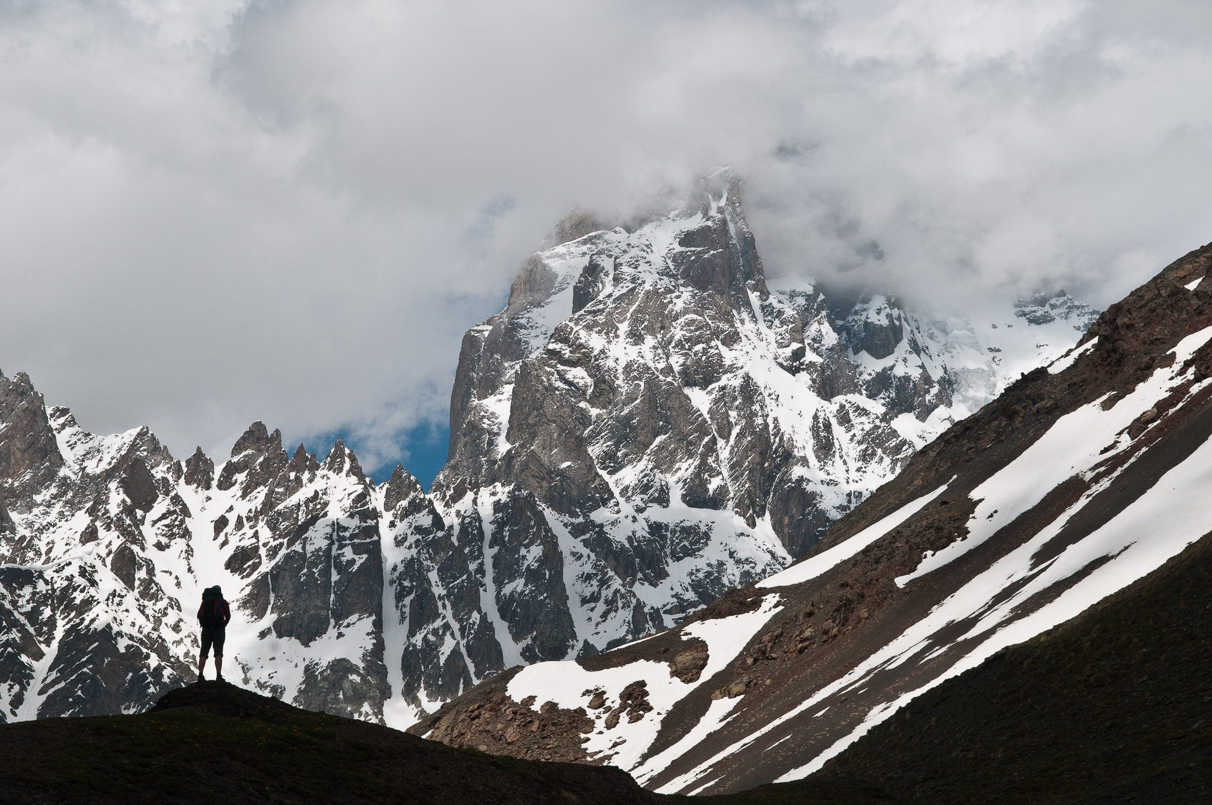 Woman and Kazbegi Mountain, near Mestia, Georgia.