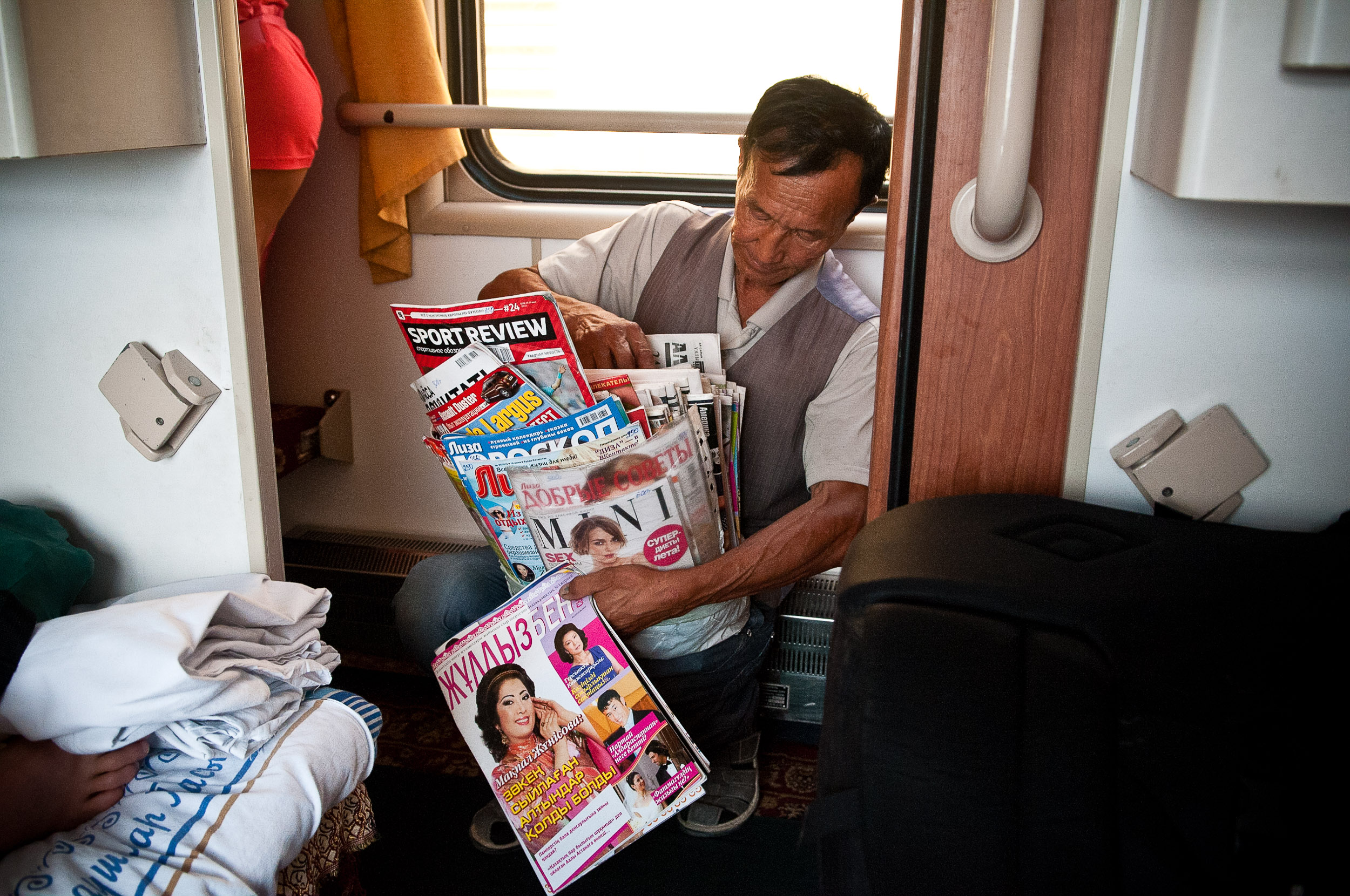 Man selling magazines, on the train, Kazakhstan.