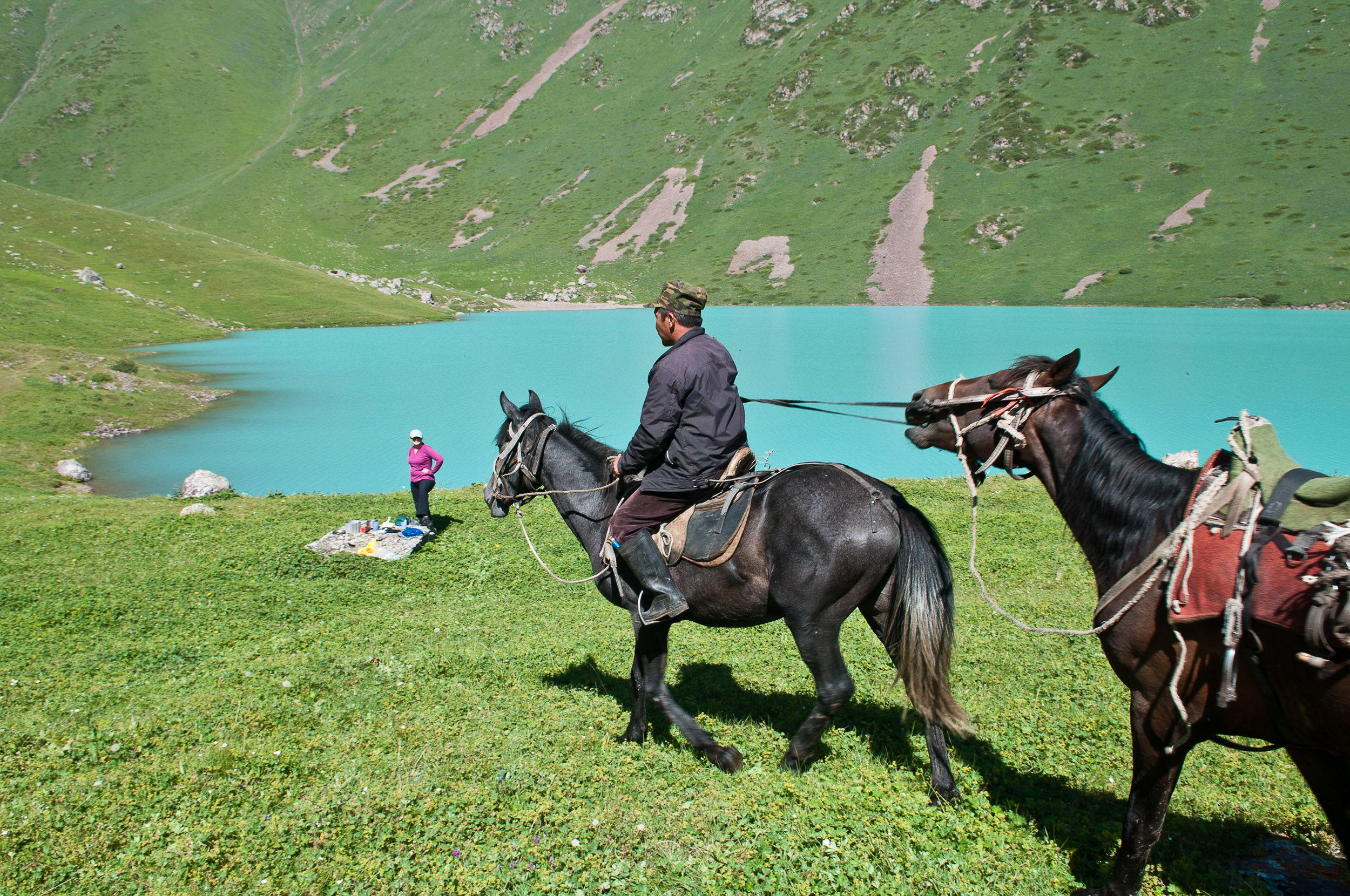 Horseman and horses in the mountains of Kyrgyzstan.