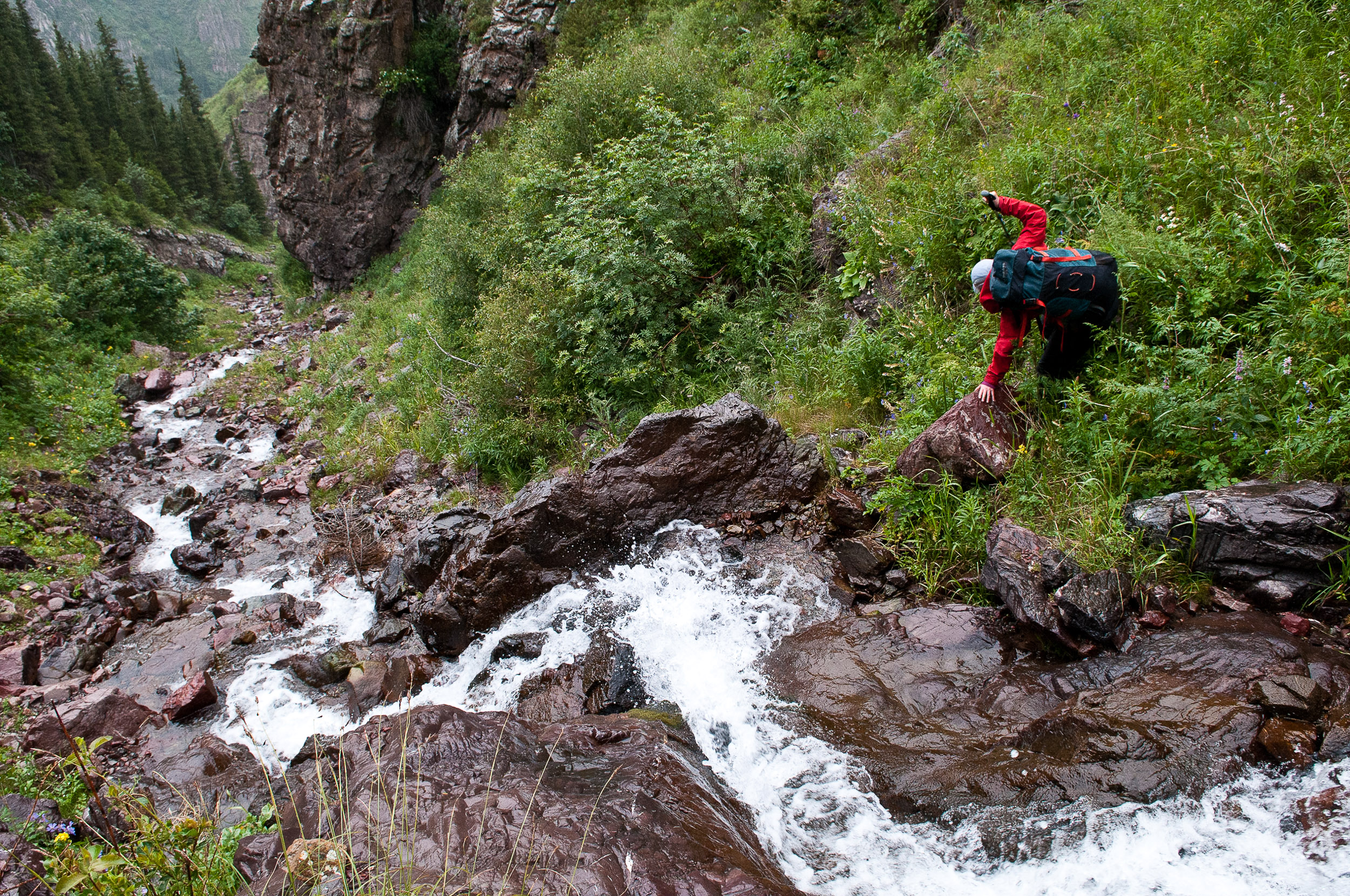 Jane negotiating steep terrain while descending from the pass, Kyrgyzstan.