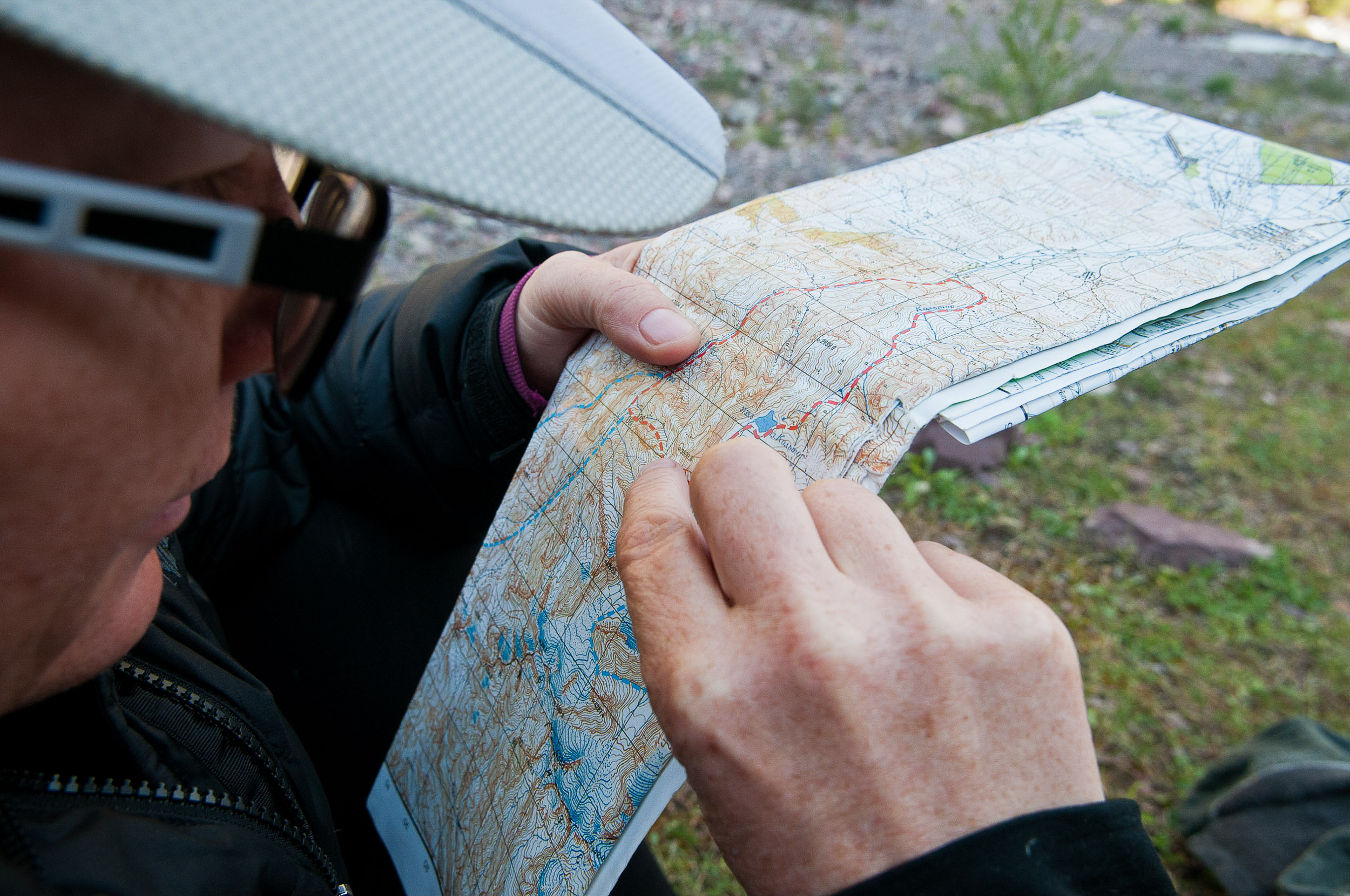 Jane studying the route over the pass, Kyrgyzstan.