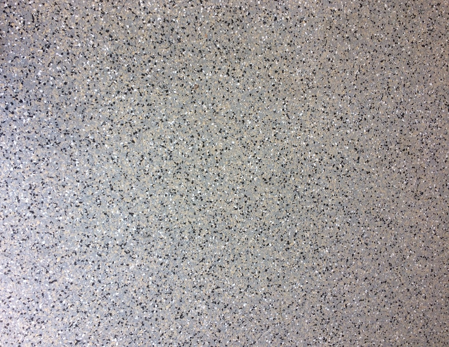 Epoxy finish makes a garage floor stylish and easy-care.