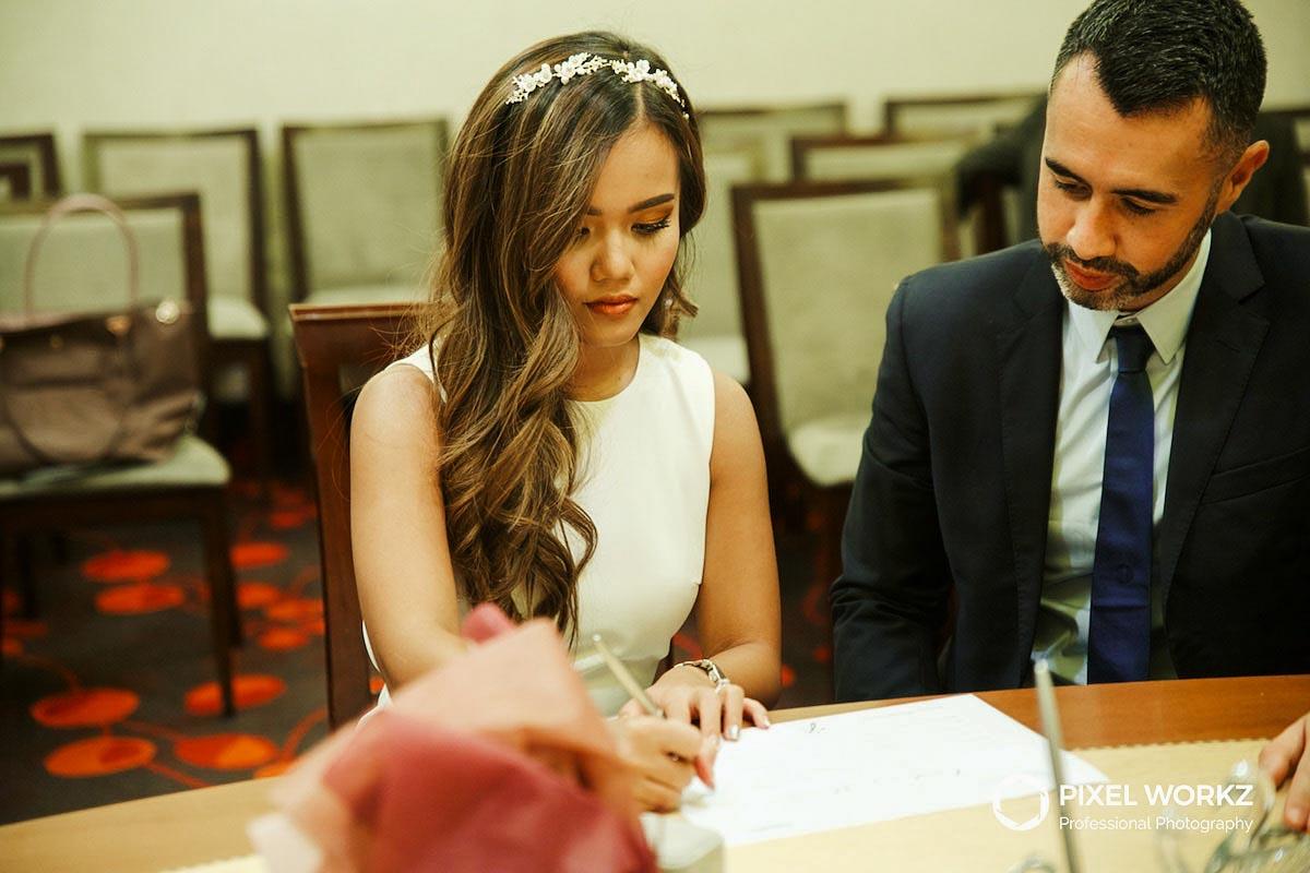 008 ROM bride signing_1.jpg