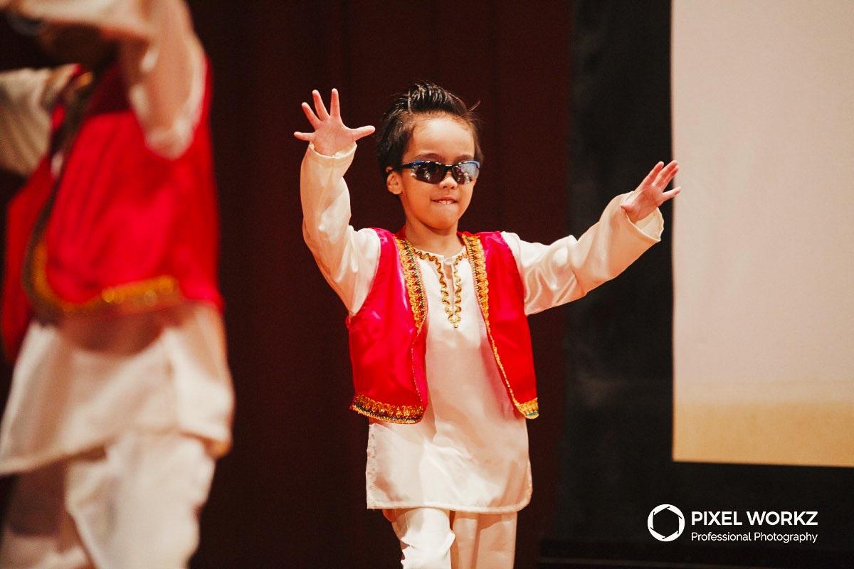 015-kid-making-dance-move-at-year-end-graduation-concert_1.jpg