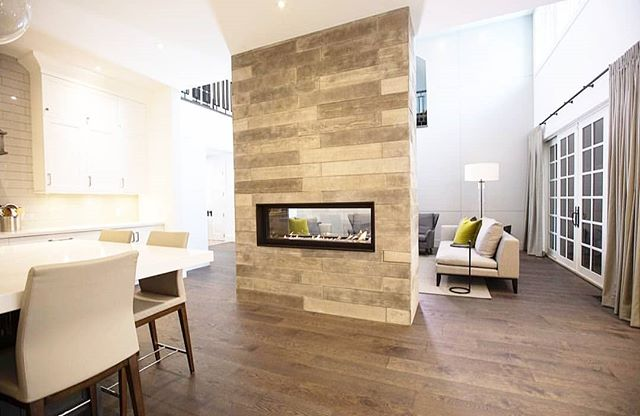 GAS FIREPLACE || A cozy two-sided fireplace connecting the kitchen and living room. The aesthetic in this room is on point. . . . #fireplace #cozy #kitchen #kitchendesign #modernkitchens #livingroom #livingroomdesign #newhome #customhome #yyc #calgary #alberta #yychomes #yycliving #yycbuilder #stonebridge #stonebridgecraftedhomes