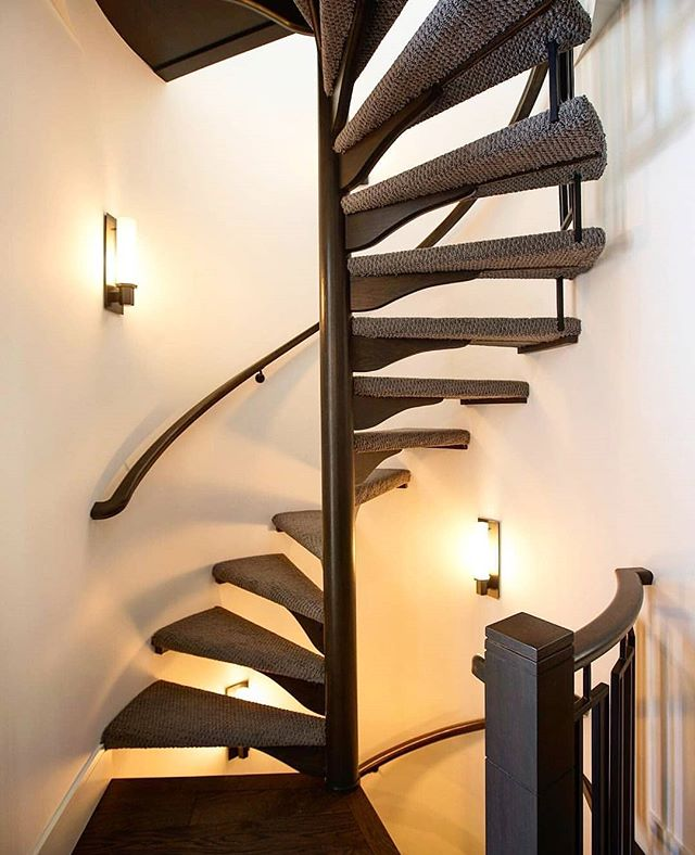 SPIRAL STAIRCASE || This elegant spiral staircase connects the scotch bar, master bedroom and yoga loft in our beautiful Baldwin home. • • • #sprialstaircase #staircase #customstairs #customhome #newhome #newbuild #lightfixture #lightingdesign #calgary #calgaryhomes #yyc #yychomes #yycdesign #yycbuilder #alberta #stonebridge #stonebridgecraftedhomes #calgaryalberta