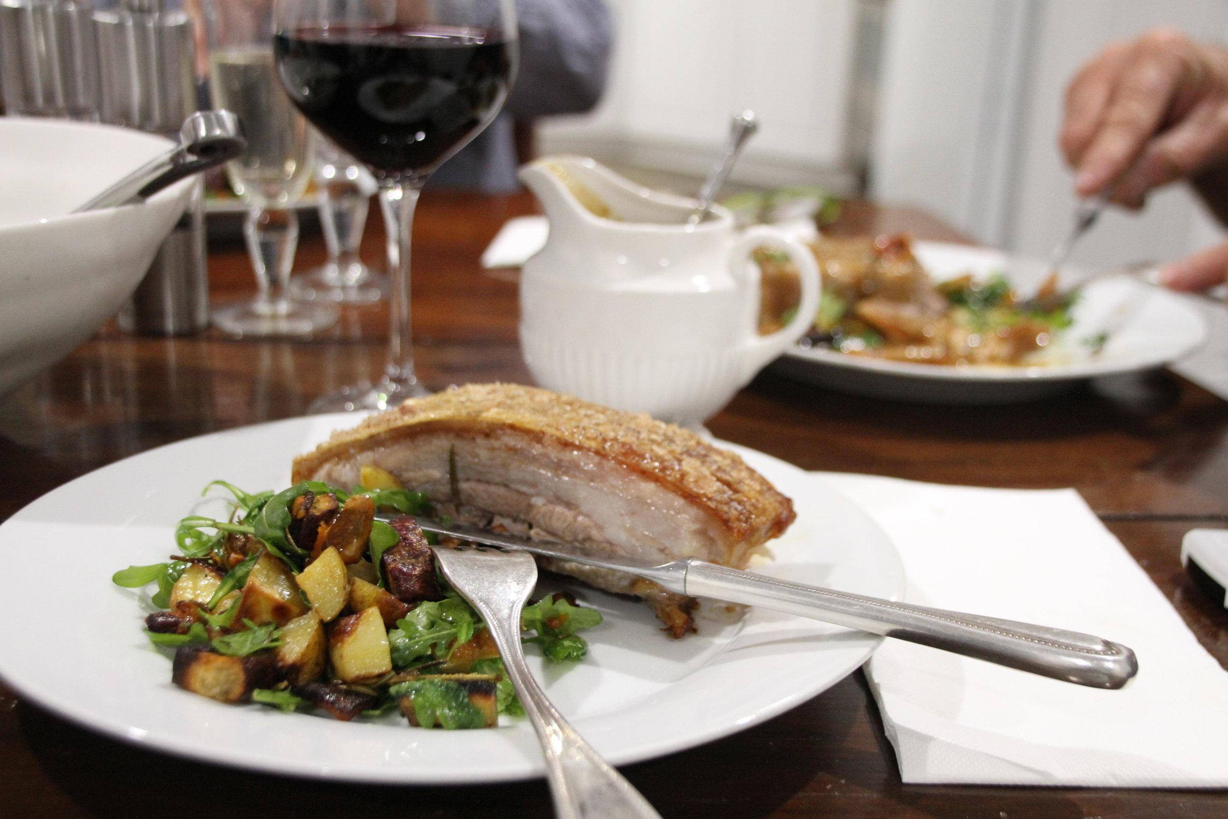 Pork belly served & roast vegetable salad.