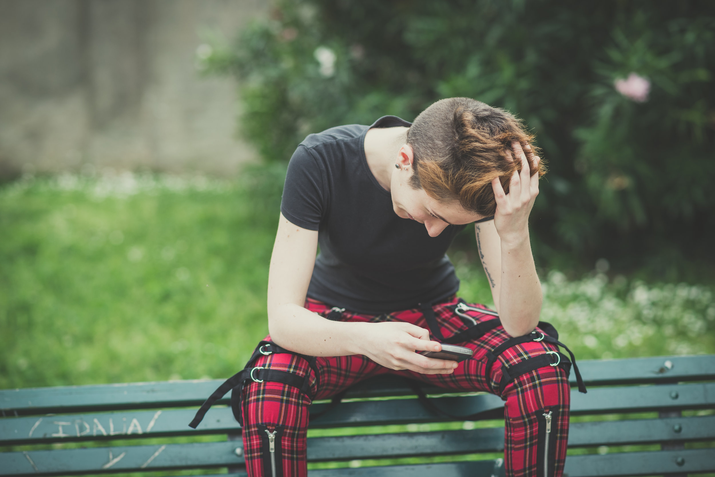 young boy on bench with phone