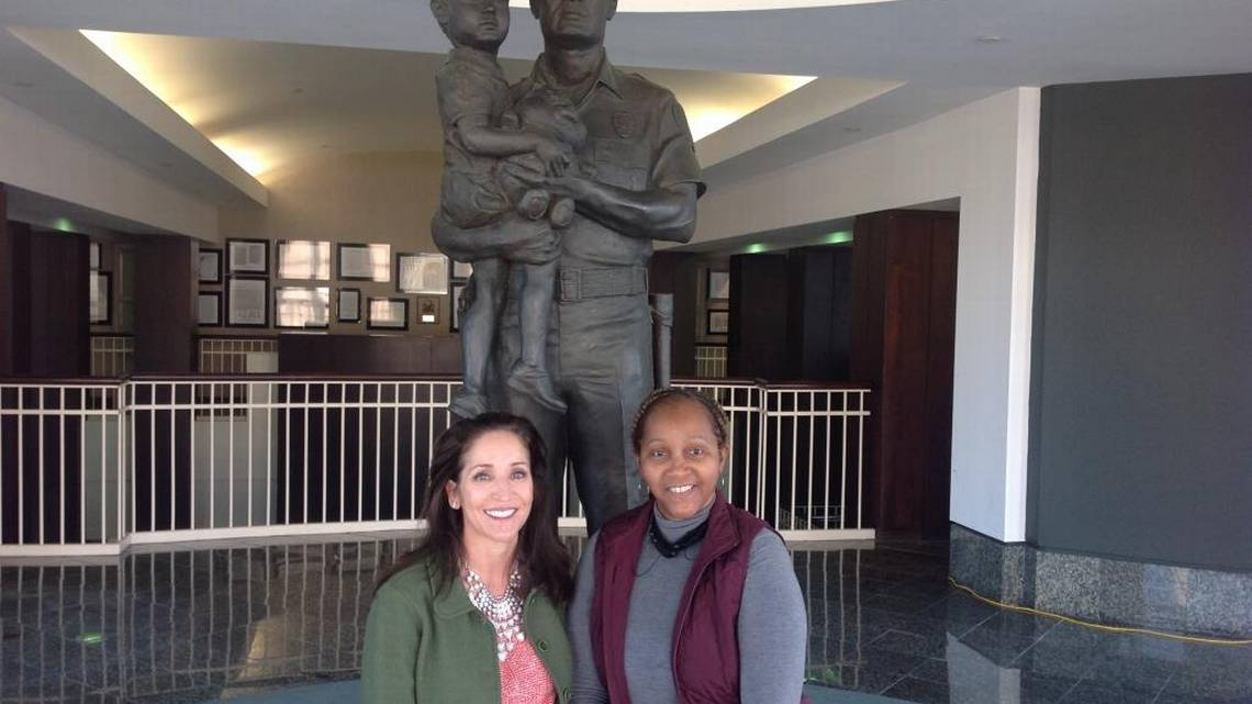 From left, Bobbi Starr, executive director of Micah's Promise, and Lt. Joyce Dent-Fitzpatrick, sit in front of a statute at the Public Safety Building. Both women are working to combat sex trafficking in Columbus.  ALVA JAMES-JOHNSON AJJOHNSON@LEDGER-ENQUIRER.COM