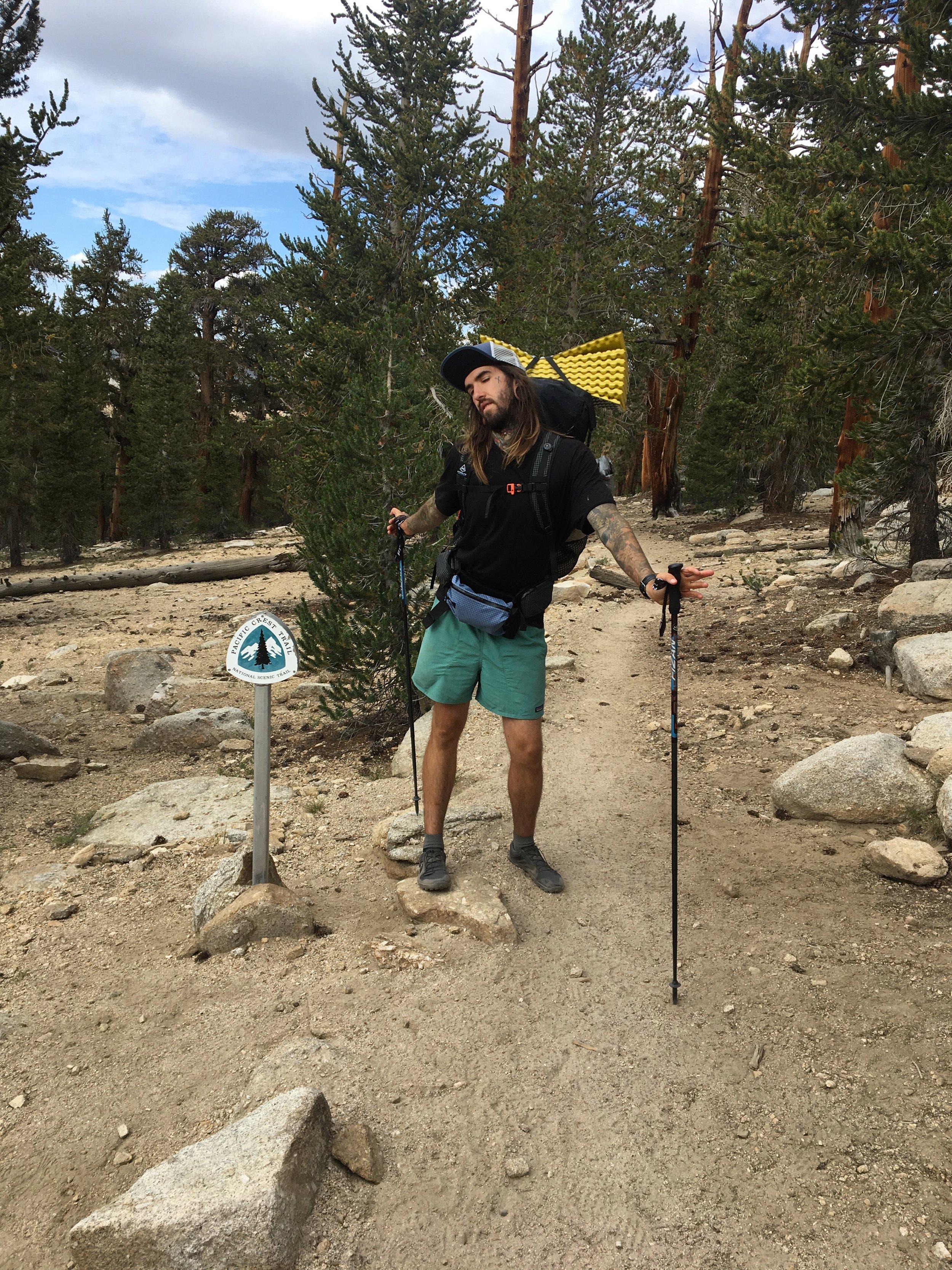 Logan by a PCT trail marker!