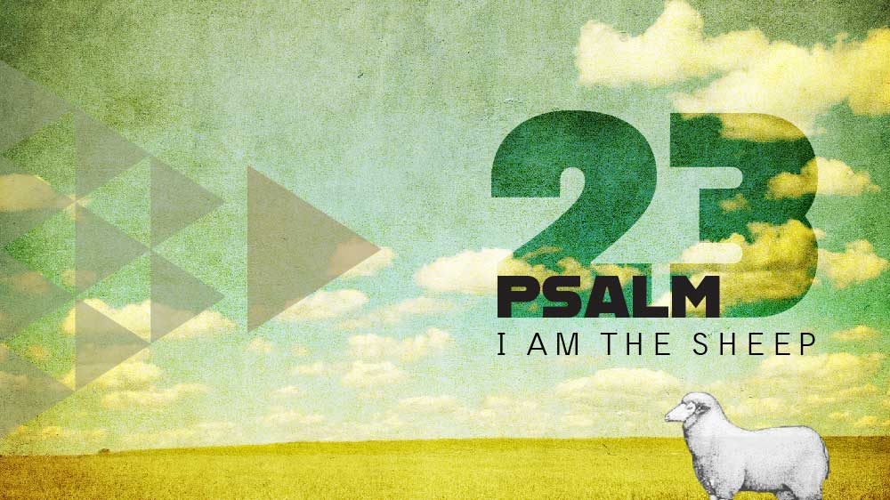 A single sheep standing in an empty pasture under a partly cloudy sky. 'Psalm 23 I am the sheep' is written on the right side