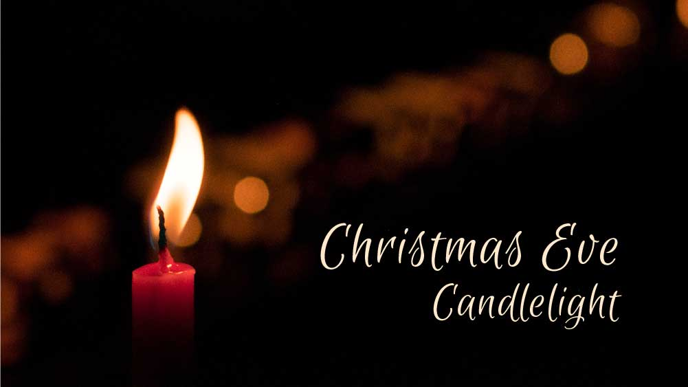A single candle is lit in a dark environment. 'Christmas Eve Candlelight' is written at the bottom.