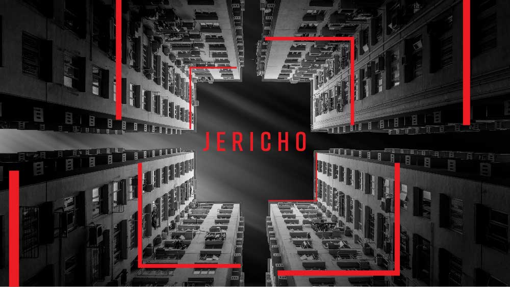 A view straight-up from the base of several skyscrapers. 'Jericho' is written across the sky in red.