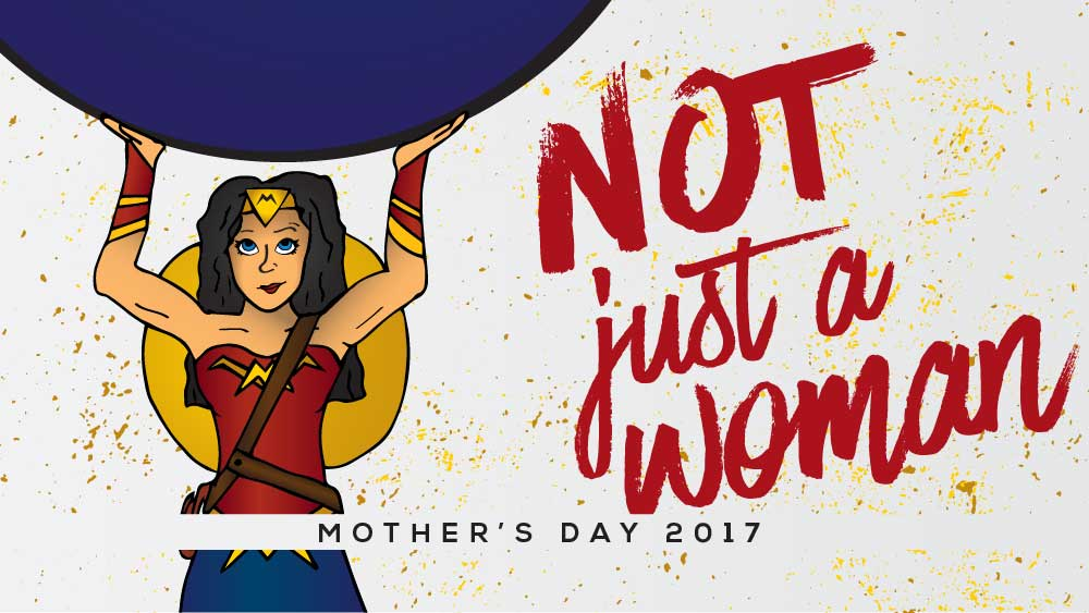 Superhero is holding a heavy weight above her head. 'Not Just a Woman' is written next to her.