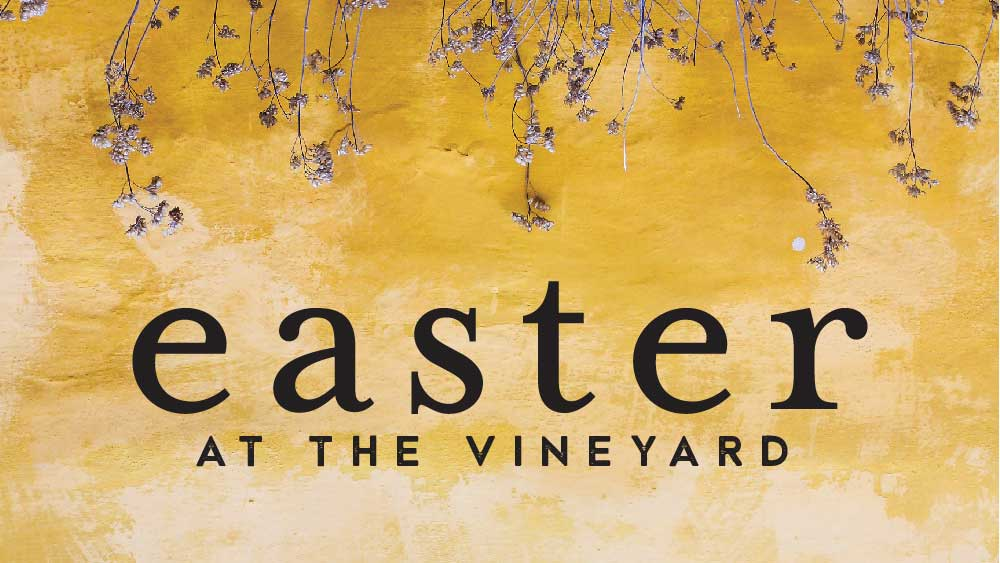 Flowers growing on a yellow wall. 'Easter at the Vineyard ' is written below them.