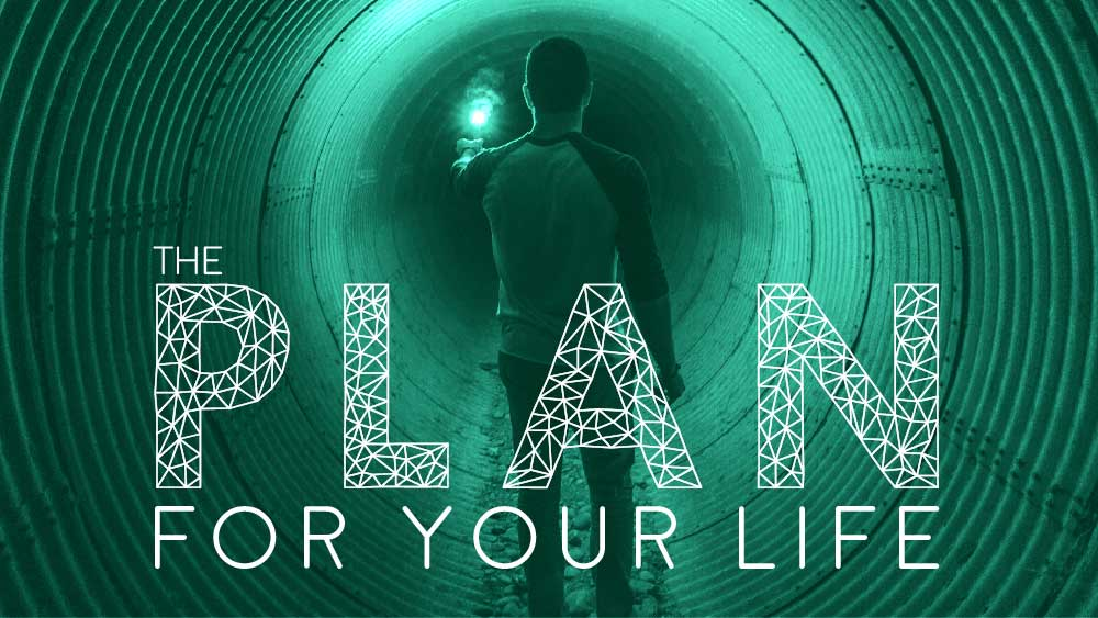 Man wanders down a large tunnel, illuminated by a single road flare. 'The Plan for Your Life' is written below him.