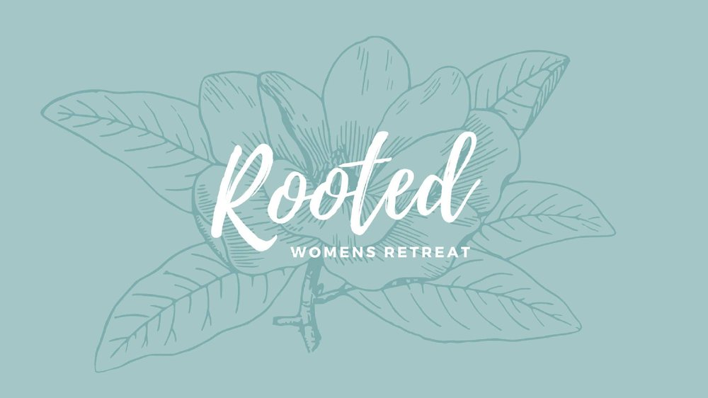 A teal background with the outline of a flower 'Rooted Women's Retreat is written on top'