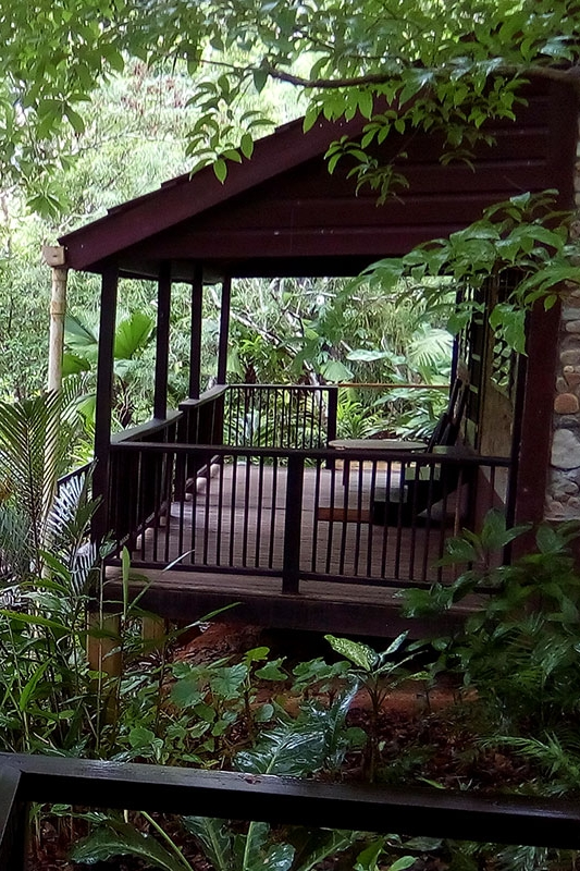 Bungalows - Bungalows offer one king bed and a full futon. Holds 1-4 guests.