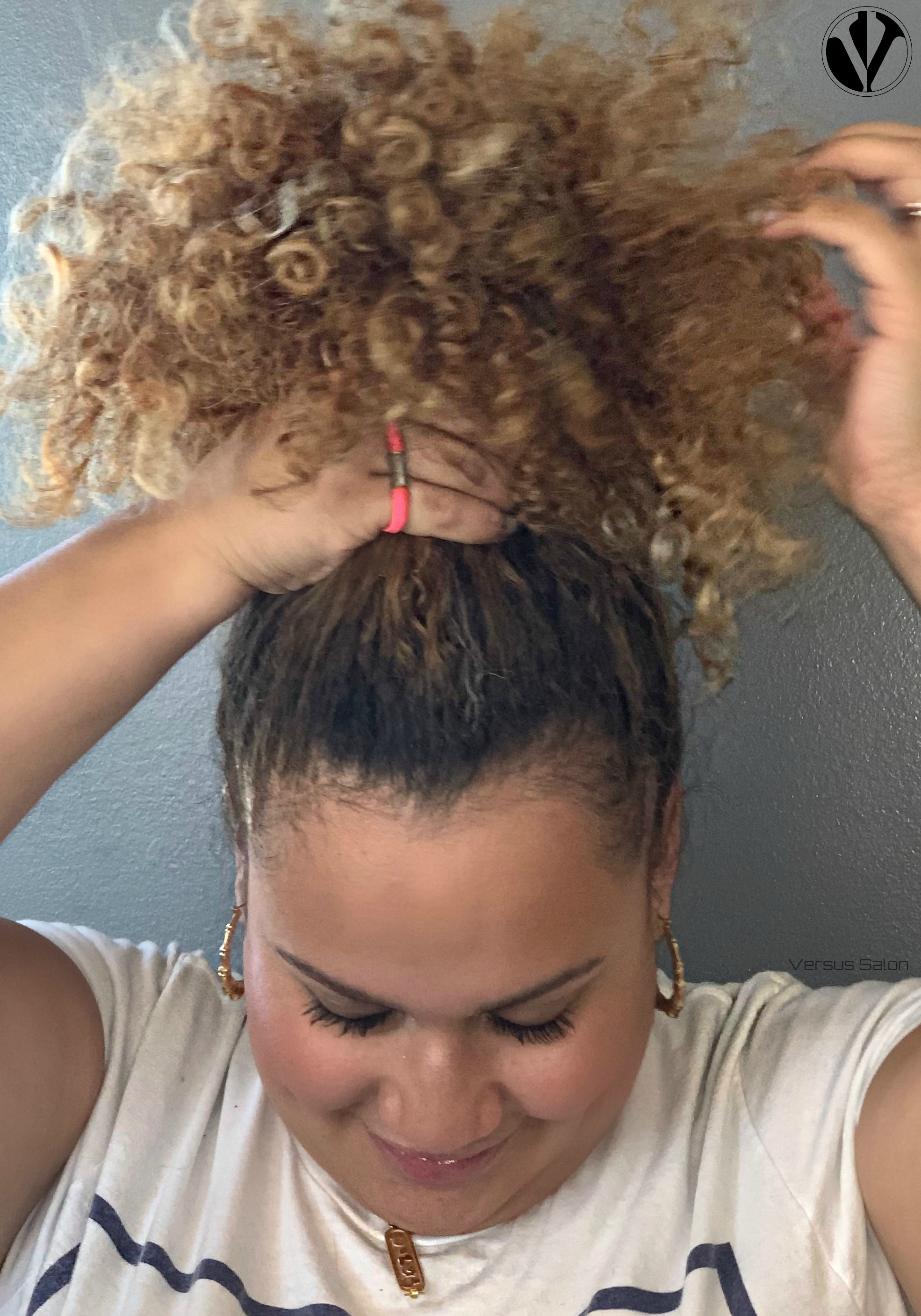Pull your curls onto the crown of your head and secure  very loosely  with a silk scrunchie or ponytail holder