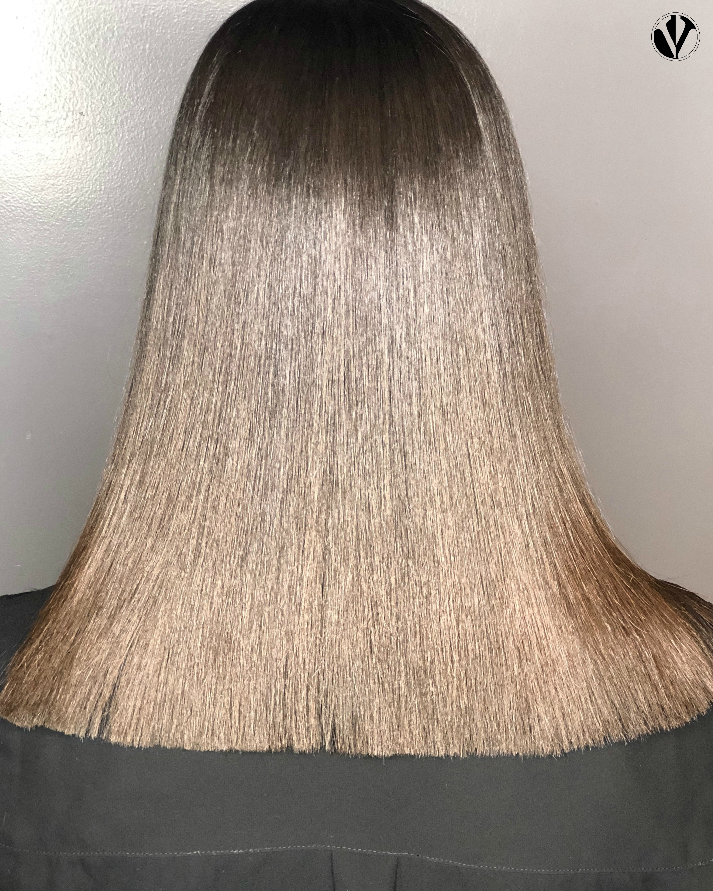 This photo shows the result of an End Trim service where the hair is all one even length