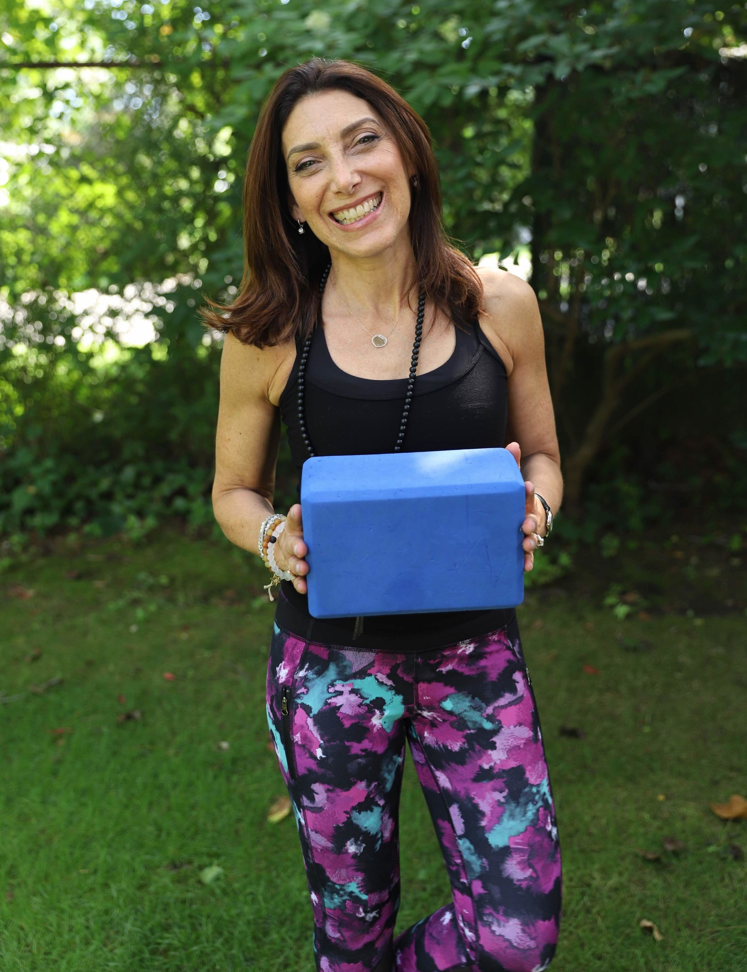 """SHARON - """"My experience being coached by Emily exceeded my expectations! The results were SO positive and successful-- I'm now making more money, commuting less, and enjoying more time to myself. I had hesitations about working with her as I did not know her very well beyond her social media presence and being about twice her age I was concerned that we would feel the age gap. Emily's younger age and strong handle on social media use turned out to be assets to our coaching relationship. She helped me get clarity around how to increase my income by focusing on private clients. She helped me to see and own my value as a yoga teacher. """" Sharon"""