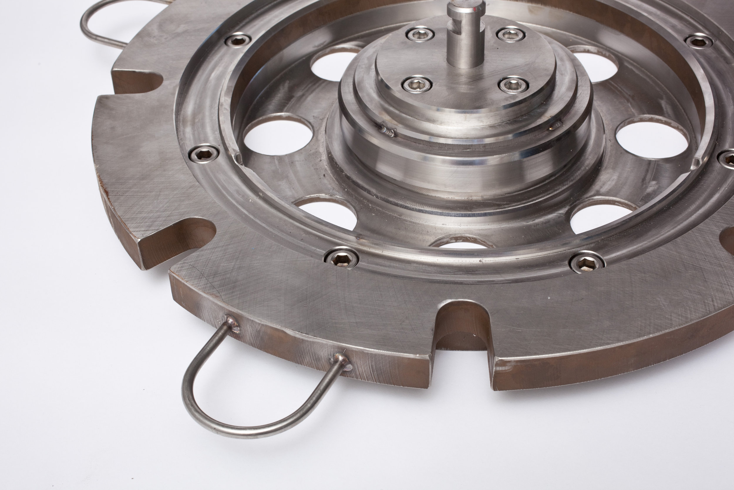 Heat Treat Fixtures - Our heat treat fixtures correct the distortion that results from some casting processes. To achieve this, we build a fixture to replicate the original size and shape of the distorted part. The foundry loads the problem part into our custom fixture, and places it in an oven heated to very high temperatures. The fixture, typically made from 316 stainless steel, expands at a higher rate than the cast part, forcing the casting into its proper shape which is maintained as the part cools.