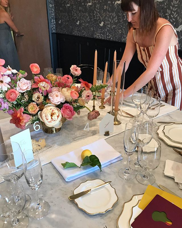 Mock-up in progress! Here's a little BTS shot of our designer, Jamie, styling the table before our clients see it! this wedding is going to be GORGEOUS! @bestdayeverfloraldesign @treslagroup @premiere_rents @latavolalinen