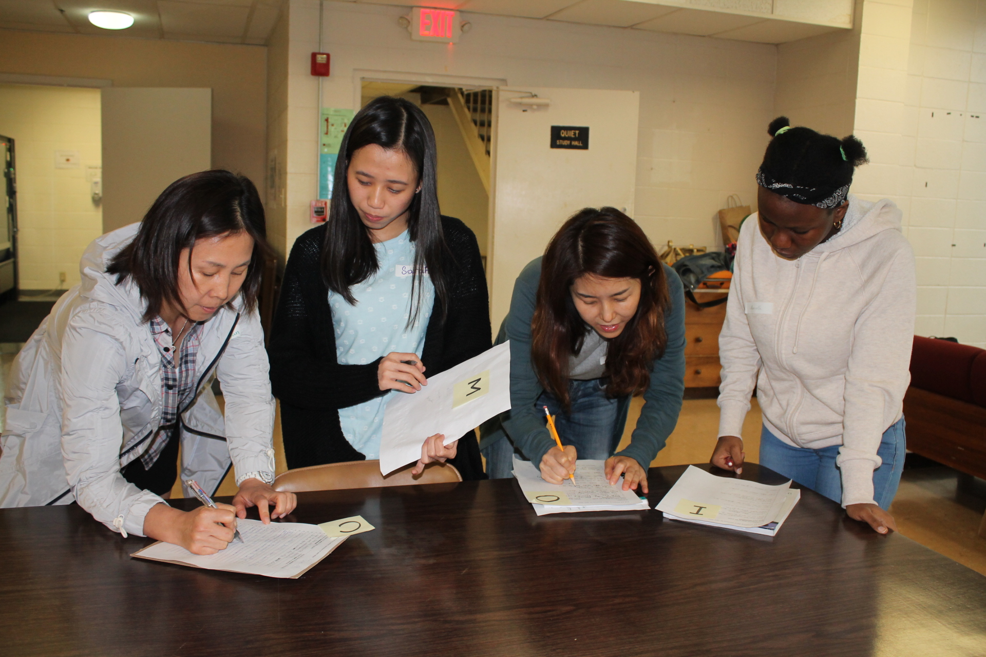 Photo of Texas International Education Consortium program participants working on homework.