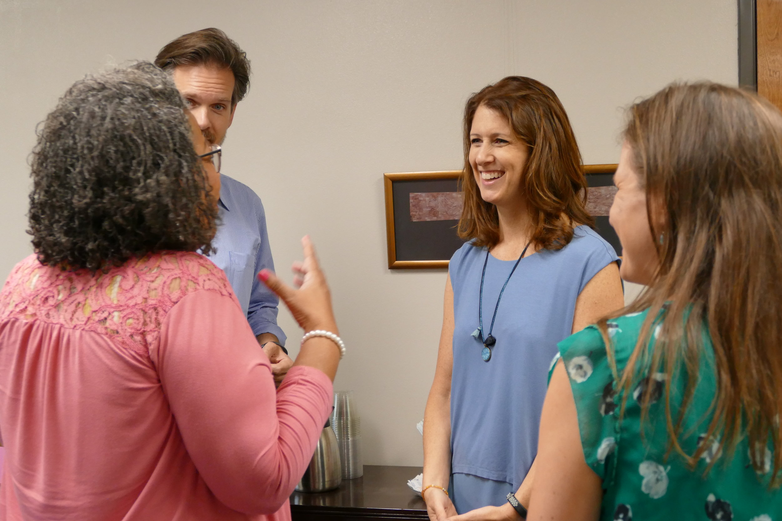 TIEC executive staff members Robin Lerner and Ryan Buck talking with program participants.