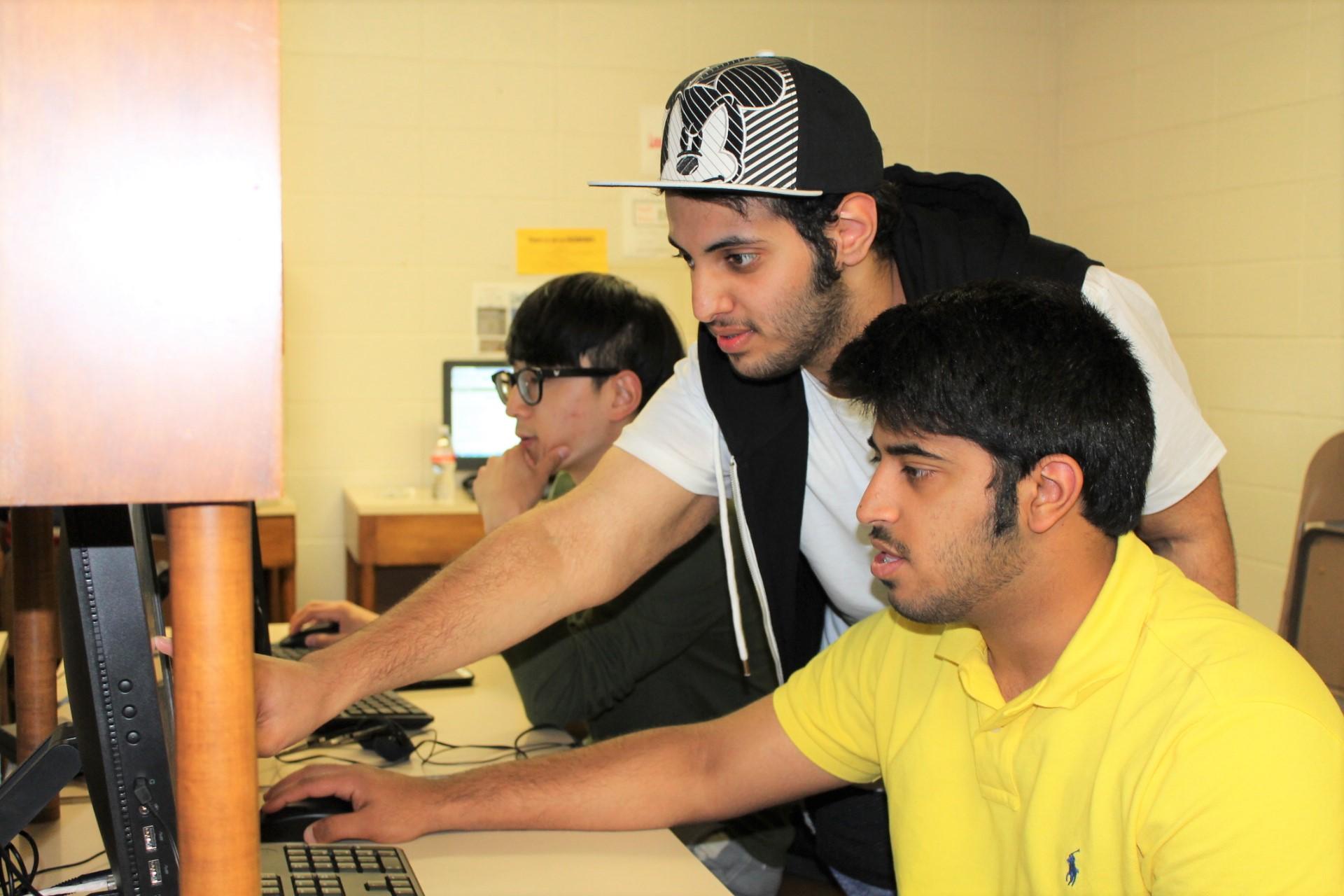 Photo of Texas International Education Consortium students working online.