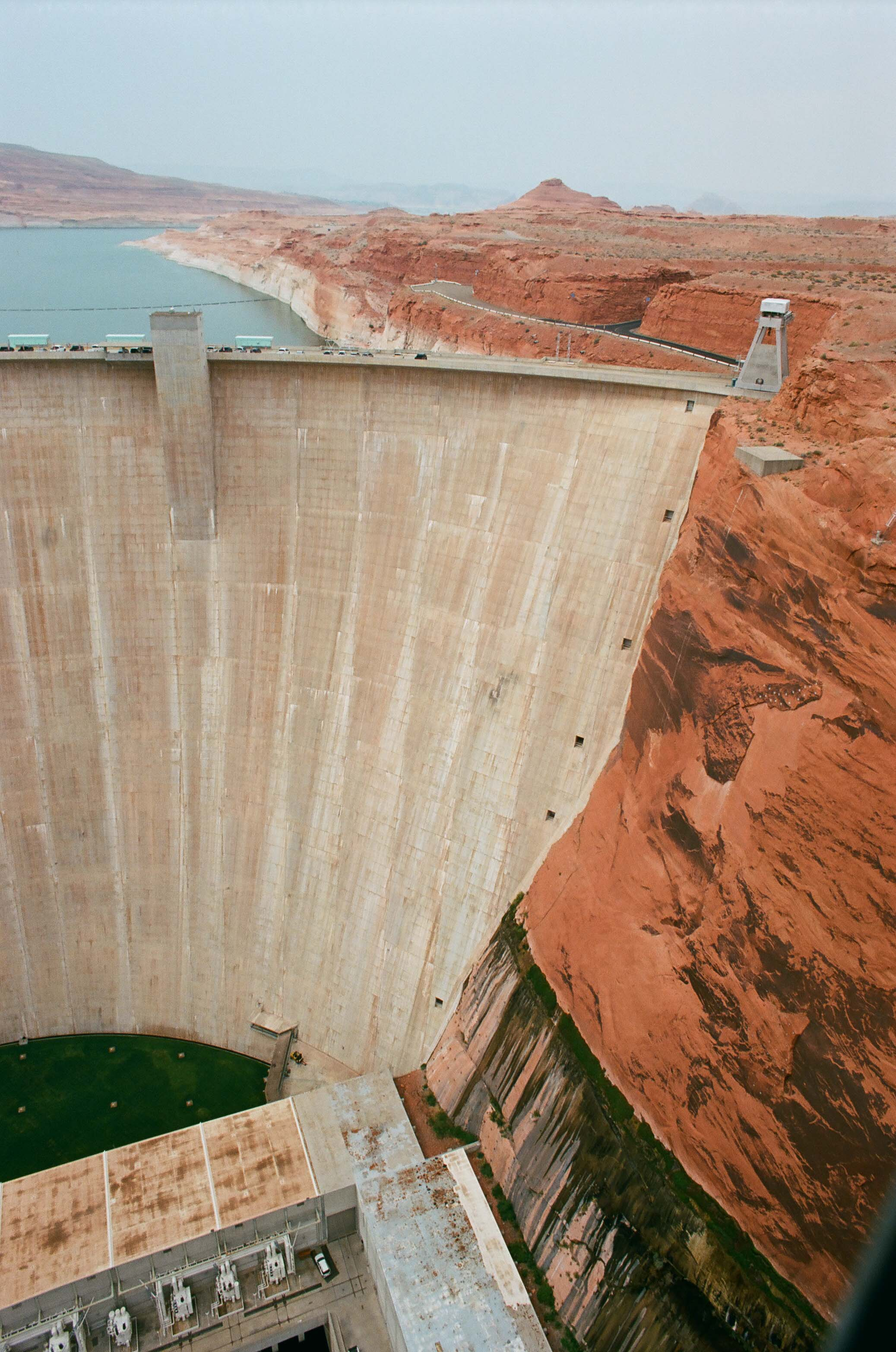 The Glen Canyon Dam which created Lake Powell and submerged 110 miles of scenic canyons and made Rainbow Bridge, a Sacred Navajo arch, only accessible by boat