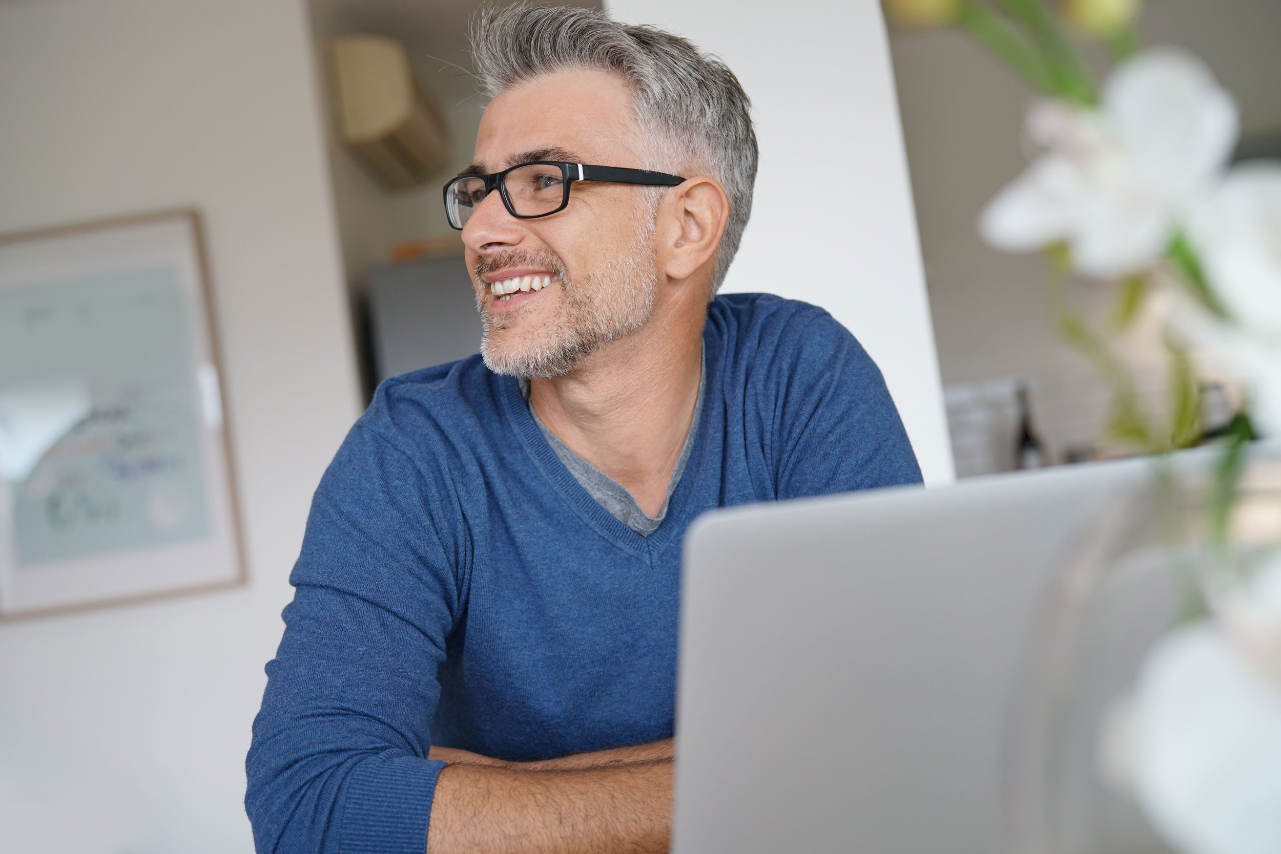 bigstock-Middle-aged-man-working-from-h-210795856.jpg
