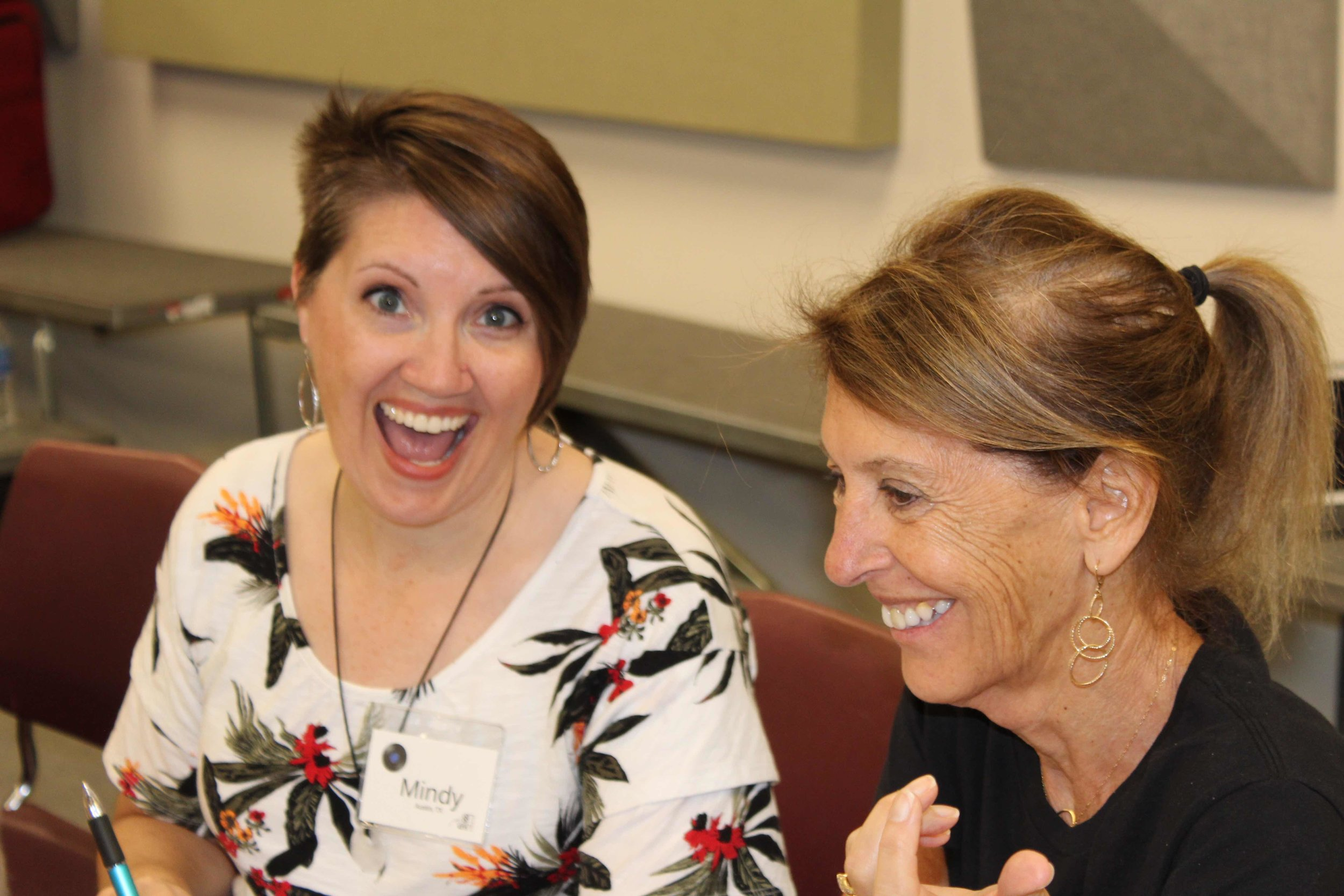 Mindy smiling for the camera sitting next to Andrea West, Ms  88PK graphics  guru