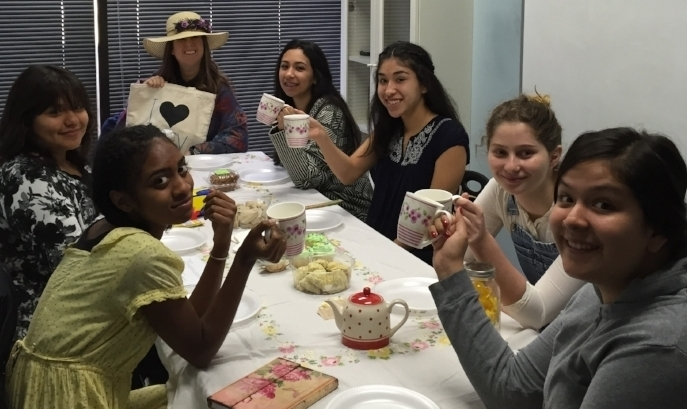 Strong Women in Literature Tea Party: Each student came dressed as her favorite strong woman in literature, answered questions as her character, and gave advice to one other character from something her own character learned. Pictured clockwise from Batsheva in the hat: Lizzie Bennett (Pride and Prejudice) , Alice (from Wonderland), Tita (Like Water for Chocolate), Idgie (Fried Green Tomatoes),  Jane Eyre, Nettie (The Color Purple) and Evelyn (Fried Green Tomatotoes)