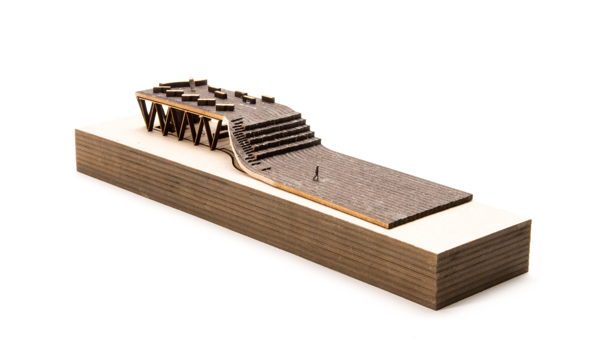 These sectional models were created to display an earlier iteration of the design, highlighting the dual sets of seating and the storage areas.