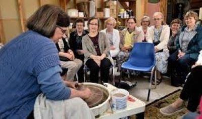 Karen Sensenig demonstrating work at the pottery wheel.