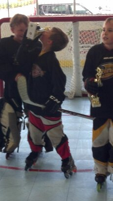My kid kissing his first inline hockey trophy. Might have missed the point of this posting….