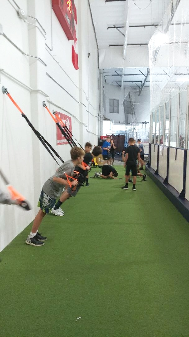 Lunchtime dry-land training between ice sessions at hockey camp.
