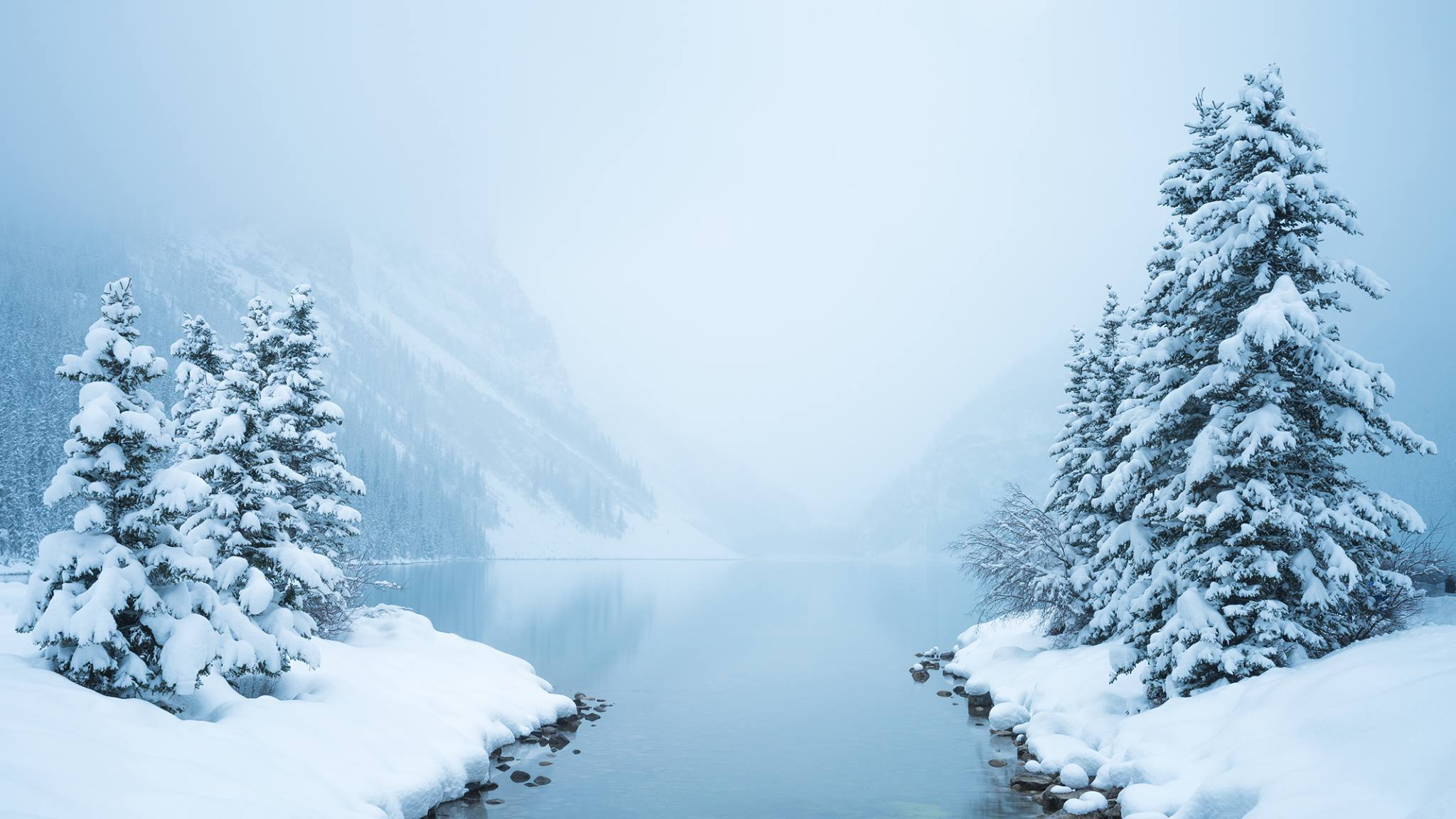 "Lake Louise in Banff National Park during a snowstorm. A 10-stop neutral density filter was used to ""see through"" the snow as it was falling.  Nikon D810 