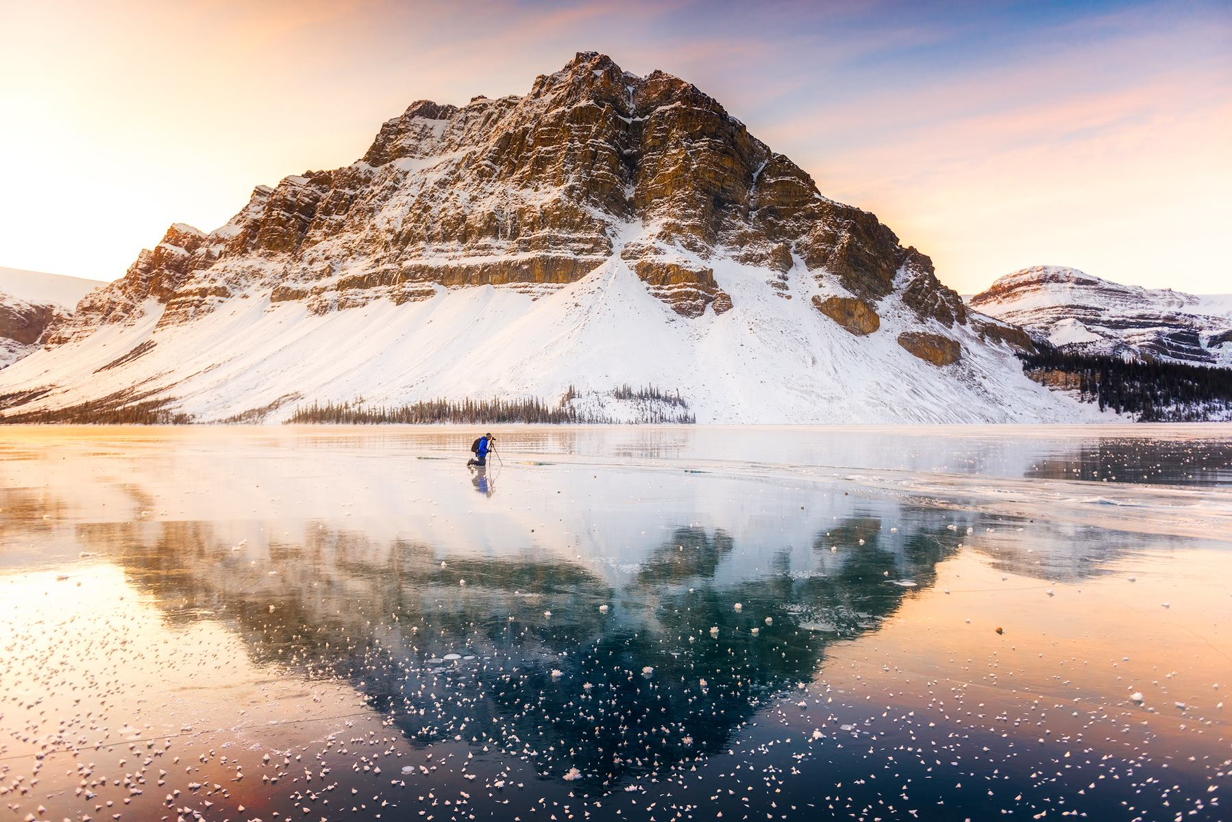 A lone photographer on Bow Lake at sunrise in the Canadian Rockies.  Nikon D810 | Nikon 14-24mm