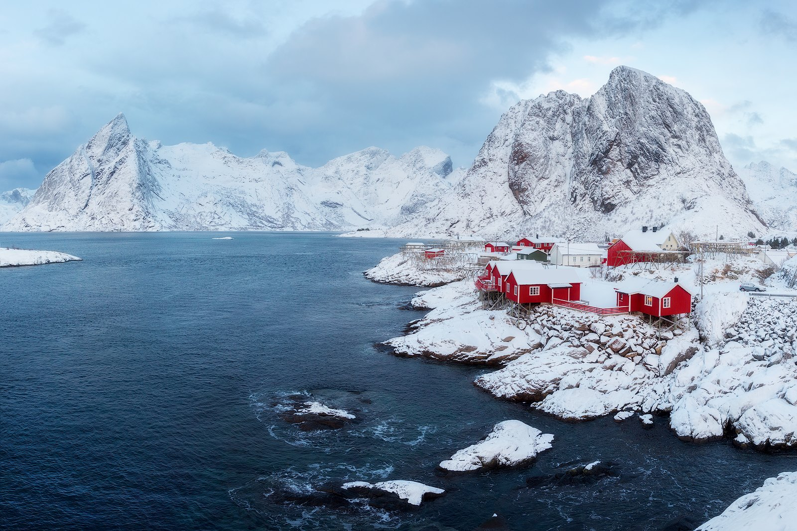 The stunning red cabins of Hamnoy, Norway after a winter storm.  Nikon D850 | Nikon 14-24mm
