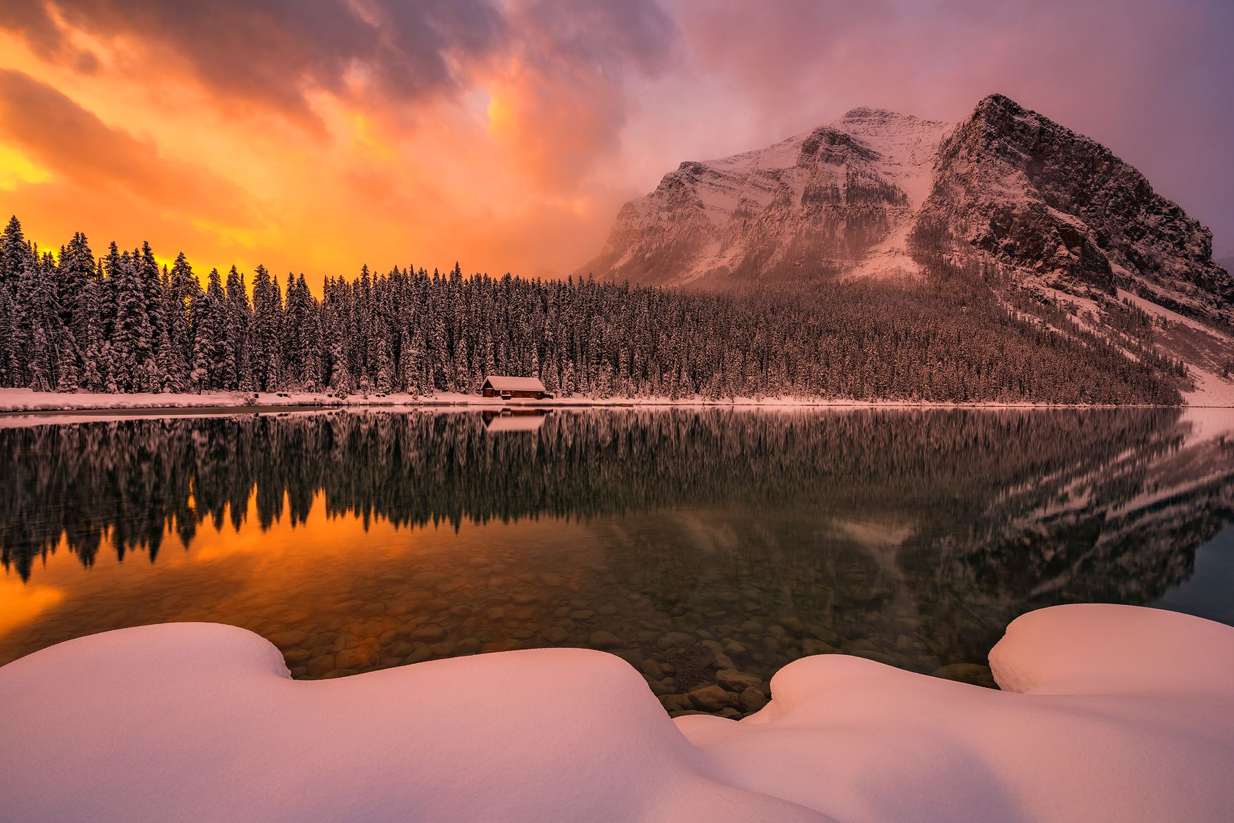A winter sunrise during subzero temperatures at Lake Louise in Banff National Park . Nikon D810 | Nikon 14-24mm